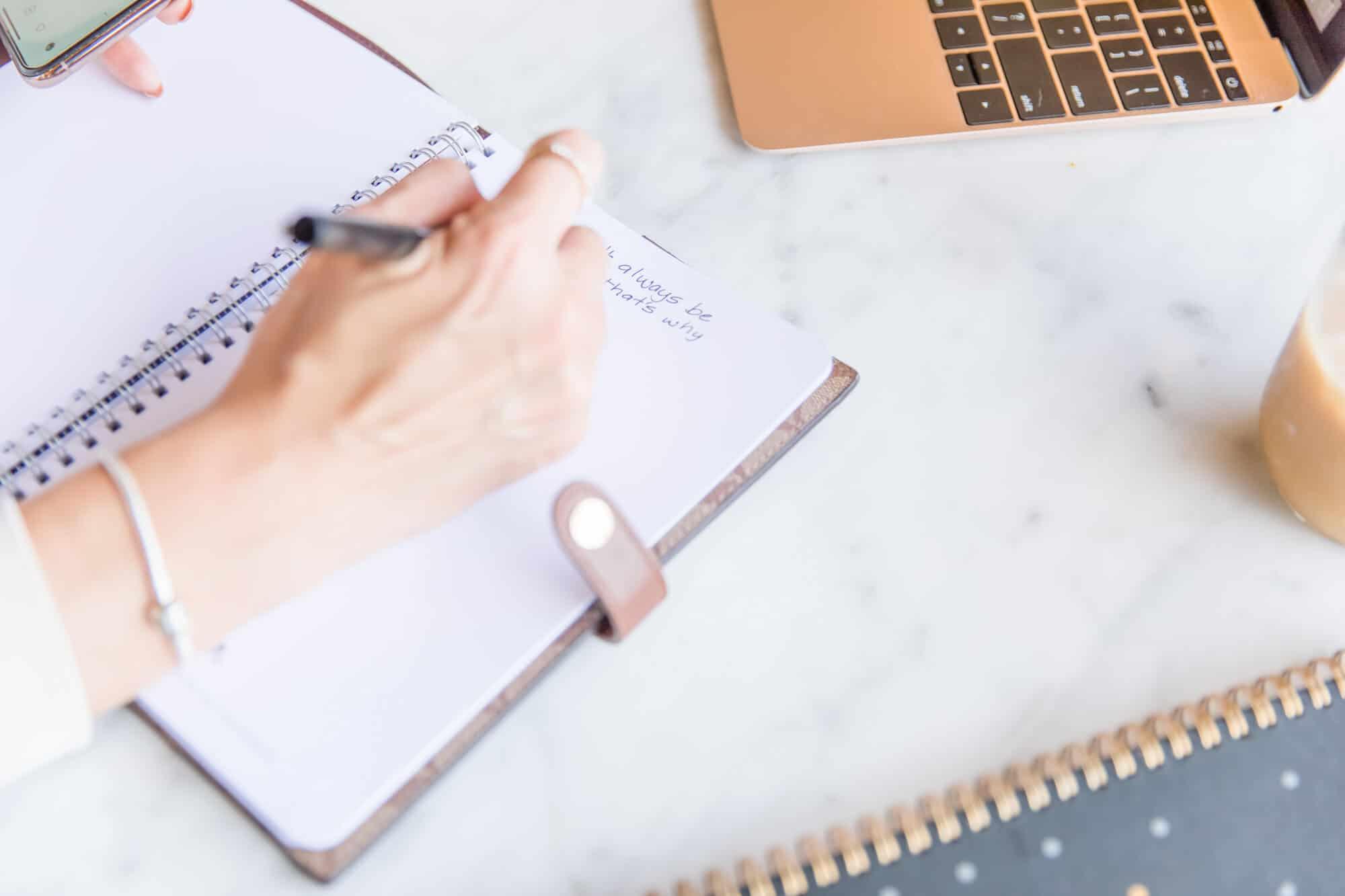 Web designer taking notes